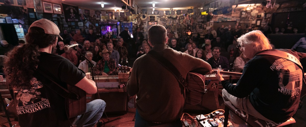 Flora-Bama-Frank-Brown-Songwriters-Festival-stage-facing-audience-500px-tall